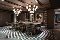 Two Tom Dixon PLANE chandeliers sit in the centre of this Hong Kong Playhouse dining room. Photo by Dennis Lo
