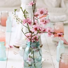 A simple mason jar with cherry tree blossoms.  Looks sweet with the pink lemonade in the mason jars used as glasses.
