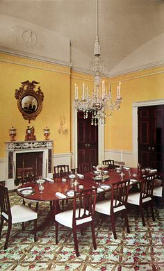 The Family Dining Room during the administration of John F. Kennedy. The room remains little changed since redecoration by Sister Parish for the Kennedys.