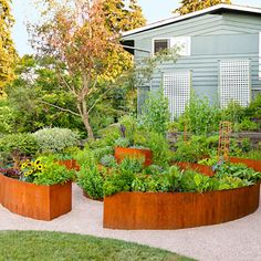 the curves on this raised garden. I would put a bench in the middle so we could sit and have a rest and admire our veggies, a glass of wine. Urban Garden Design, Raised Bed Garden Design, Raised Vegetable Gardens, Vegetable Garden Design, Modern Landscaping, Yard Landscaping, Landscaping Ideas, Garden Edging, Garden Planning