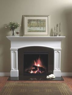 Fire place mantle but with small herringbone tile surround in a light color instead of the black tile