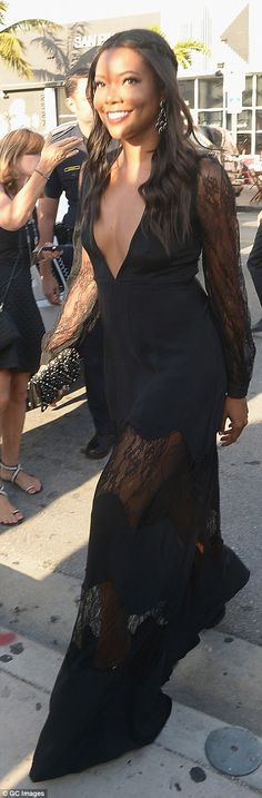 Singer Gabrielle Union went for a similarly racy look in a dress that was slashed to just above the navel, while the lace skirt showed off her slim legs