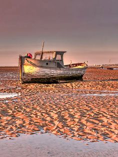 Waiting For The Tide is a photograph by Michael Janik. Source fineartamerica.com