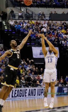 Kentucky guard Isaiah Briscoe (13) shot a three pointer over Wichita State forward Rashard Kelly (0) in the first half of the Kentucky vs Wichita State NCAA Tournament second round game at Bankers Life Fieldhouse in Indianapolis on March 19, 2017. FIRST HALF