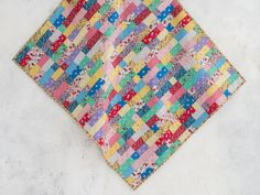 Brick Wall quilt - A precut-friendly top with 1930s vintage floral fabric – the only brick wall worth running into!