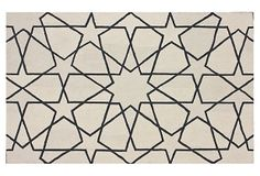 Digging the star pattern on this gorgeous black and white rug.