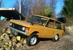 Classic Bahama Gold 1972 Range Rover showing off its awesome axle articulation. Range Rover Classic, Range Rover V8, Landrover Range Rover, 4x4, Old Boats, Land Rovers, Dream Garage, Car Stuff, Jeeps