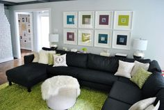 Love the custom prints, paint color (Moonshine by Benjamin Moore), and bright green rug against the dark sectional (from Ikea). Of course, since it's from YHL, it's amazing!