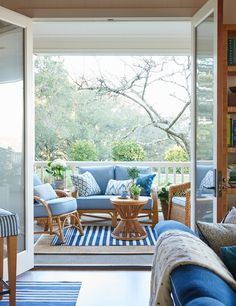 How to layer the shades of the same color and the same type of pattern in the same room. Blue and white. Image via Mark D. Sikes