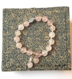 Bracelet perles quartz rose et tête de Boudha en hématite couleur argenté par Ocelyane