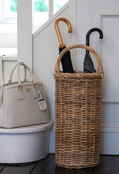 Woven Rattan Umbrella Basket with large curved handle over the top and practical removable internal metal drip tray. Wire Baskets, Storage Baskets, Rattan Basket, Wicker, Tall Basket, Basket Lighting, Decoration Inspiration, Hallway Inspiration, Upcycled Home Decor
