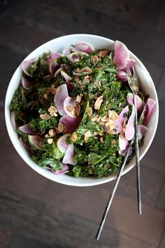 Kale topped with watermelon radishes, apples, and slivered almonds makes for an incredibly appealing salad (and a pretty presentation).