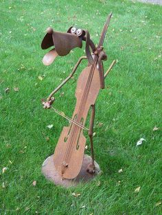 "Doggone Musical!...  Cute sculpture at Jurustic Park in Marshfield, Wisconsin  - photo by Clyde Wynia, via Flickr;  Jurustic Park is an unusual ""museum"" of rusted creatures (including dinosaurs) made of recycled metal."