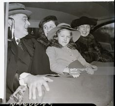 3/4/1938-Washington, DC- Accompanied by members of his family, President Franklin D. Roosevelt is pictured in his automobile this morning on the way to St. John's Episcopal Church for the special religious service that marked the fifth anniversary of his inauguration as president of the United States. Pictured (L-R) are: President Roosevelt; Mrs. James Roosevelt, his daughter and law; Sara Roosevelt, granddaughter; and Eleanor Roosevelt.