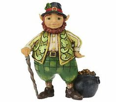 "Jim Shore Heartwood Creek. Front view ""Luck of the Wee Folk"" #4025795. . Introduced 2011. Small Irish leprechaun w/ pot of gold and walking cane figurine. 5-1/4"" H x 2-1/4"" W x 4"" L"