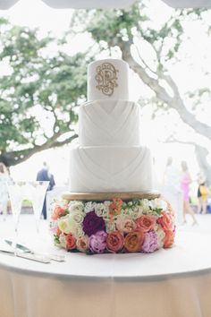 White and Gold Wedding Cake on Flower Stand | photography by http://www.paigewinnphoto.com