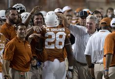 Malcolm Brown (28) and head coach Mack Brown