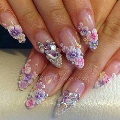 3D flowers on pink French mani stilettos.