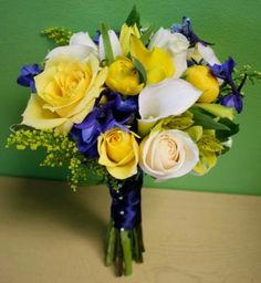 I love this bouquet i would add a few white flowers to really make blue and yellow bouquet mightylinksfo