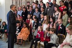 President Barack Obama speaks with students in the State Dining Room prior to the White House Student Film Festival in the East Room of the White House, Feb. 28, 2014.