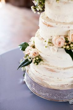 Georgia Wedding - Naked Cake - Simple wedding cake, barely iced.  Perfectly adorned with roses, hypericum berries and camellia leaves.  photo by @lettersandlight cake by @roxiecrainseale , and the Fourth and Cherry crew.
