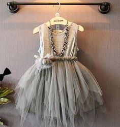 Your little one with love this cute and girlie gray dress.