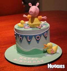 This is a white chocolate mud cake with dark chocolate fondant on it. Peppa pig is her favourite and she loves swimming that is why peppa was created with a swim gear.
