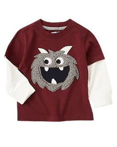 Fuzzy Monster Double Sleeve Tee  Item #140103613Email to a friend  Faux sherpa appliqués give his layered tee cool monster style.  100% cotton jersey  Features faux sherpa appliqués and embroidery  Inset sleeve  Machine washable; imported