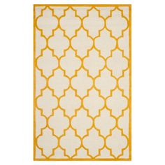 Soften your bedroom or living room scheme with this hand-tufted wool rug, showcasing a quatrefoil motif in gold and ivory tones. Prod...