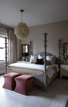 Contemporary Traditional Bedroom: Tall bed posts and square velvet stools atop patterned area rug..