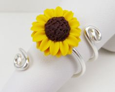 This hand sculpted Sunflower is created to wrap a decorative 925 sterling silver adjustable ring base. The base is very sturdy with room for slight adjustment within your choice size. Flower size about sterling Silver wire base Girls Jewelry Box, Couple Jewelry, Bridal Jewelry Sets, Silver Pendant Necklace, Silver Earrings, Silver Jewelry, Stud Earrings, Diamond Jewelry, Onyx Necklace