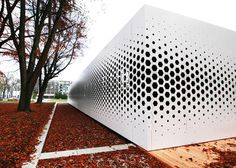 I like the exploration of perforation scale up to window size. Format Elf Architekten added a pattern of hexagonal holes to the long aluminium facade of this office building in Germany to control the amount of daylight entering the interior Architecture Design, Parametric Architecture, Parametric Design, Facade Design, Contemporary Architecture, Landscape Architecture, Exterior Design, Design Architect, Architecture Diagrams