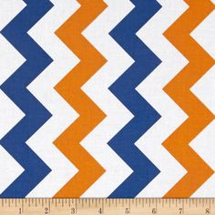 Riley Blake Medium Chevron Orange/Blue from @fabricdotcom  From the RBD Designers for Riley Blake Designs, this cotton print fabric is perfect for quilting, apparel and home décor accents. Chevron stripes run parallel to the selvage. Colors include white, orange and medium blue.