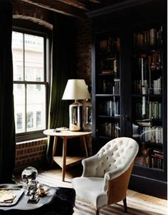 """brick walls, beautiful chair - """"My studio off the Marina in San Francisco... at the tip top center of Victorian Rooming House on Gough St, up the hill from Union St. and The Bus Stop.  Matchbox kitchen, very high ceilings, no actual closets and  bathrooms down the hall.   Early 70' s -   What a Dream. http://delightbydesign.blogspot.com/2009/06/color-inspiration-adding-little-drama.html"""