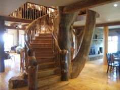 Fabulous live edge stairs and central column in unique timber frame home