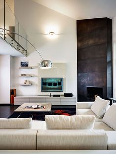 Living Room, Dark Fireplace, Villa on Lake Como by Studio Marco Piva