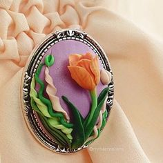 🌷 ° • ° • #jewellery #tulip #leaf #polymerclay #handmade #faux #flower #lace #pink #orange #purple #green #bright #tulips #flowers #polymer #clay #charm #pin #delicate #petals #sculpture #fimo #sculpey #cute #charming #brooch #leaves #jewelry #leaves