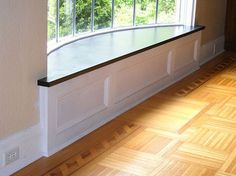 Decorative baseboard with custom bow window and stone window seat by McClurg Remodeling & Construction Services. Bow Window Treatments, Ceiling Treatments, Interior Trim, Interior Columns, Basement Lighting, Living Room Remodel, Basement Remodeling, Bars For Home, Basement Band