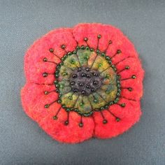 Felted Flower Brooch.  Gorgeous embellishment and coral color.
