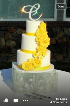 Pretty yellow and white wedding cake, also love the stand it's on. Glass blocks you could easily buy at Lowe's