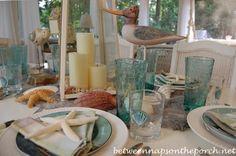 Beach Themed Table Setting with Sail Napkin Fold.