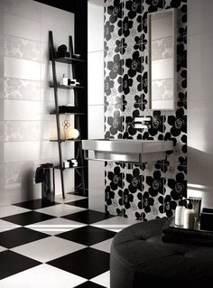 Playful minimalist black and white bathroom with bold tile patterns that keep it looking young and fresh. Give it a bit of gold and you'd have a chic glam bathroom.