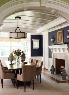 Gorgeous. Deep blue walls and a barrel-vaulted ceiling with shimmering silver paint bring drama to the dining room. I am still in love with this color combo.