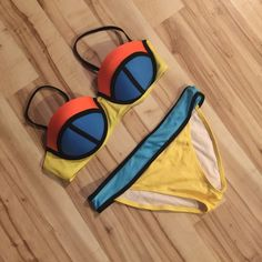 NWOT Color Block bikini NWOT super trendy bikini in yellow, blue, and orange. Bra top in size L. Can fit 34D, 36C, and similar sizes. Bottoms fit like a medium.  offers! Open to trades. Swim Bikinis