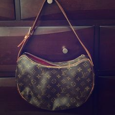 Authentic Louis Vuitton Croissant MM bag purse Pre owned great condition Louis Vuitton Croissant baguette. Clean inside (red interior) does not come with Dustbag, only a Louis Vuitton shopping bag to store it in. Louis Vuitton Bags Shoulder Bags