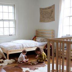 Keep the kids' room fairly simple by using a lot of natural tones to maintain a serene and calm place to sleep and play.