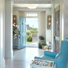 Beautiful Entry - Luvin' the blue door, the blue leather chair, and the driftwood door!