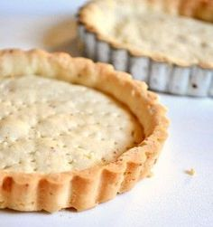 Vanilla Almond Tart Crust. This tart dough comes together easily and is much less fussy than a pie crust can be. The dough has ground almonds in it and uses cake flour, which has less gluten in it than all purpose flour, to help produce a more tender crust. This tart dough is very sticky, so it is important that you chill it well before using it. That stickiness also means that the dough will be crisp and tender after baking, not tough.