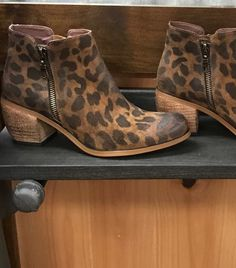 Super nice leopard booties with side zipper on both sides. These are running true to size, but are only available in whole sizes. If you wear 1/2 size, we suggest going UP to the next size FREE shipping on these !!!!