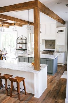 Two toned double island kitchen, Rustic Alder painted cabinets with Rub thru pec. Two toned double island kitchen, Rustic Alder painted cabinets with Rub thru pecan stain and Grizzle Grey painted center Island Rustic Kitchen Tables, Rustic Kitchen Island, Rustic Kitchen Design, Kitchen Island With Seating, Kitchen Island Pillar, Kitchen Center Island, Rustic Table, Wooden Tables, Country Kitchen